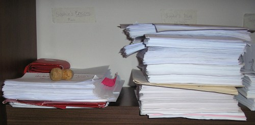 See that small pile on the left? That's Sophie's Encore. By the time Sapphire and I are done with the editing, the pile will probably be as big as the one next to it which...yes, you guessed it, is the complete round of edits and proofs for Sophie's Run. Who says us writers aren't busy??