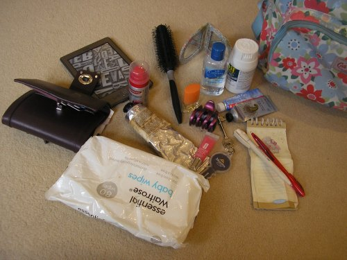 The normal contents of my rucksack... including a notepad and several pens!